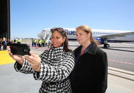 Airbus employees LaShawn Daffin, left, and Pamela May take a selfie during a post-flight ceremony. (Mike Kittrell/Alabama NewsCenter)