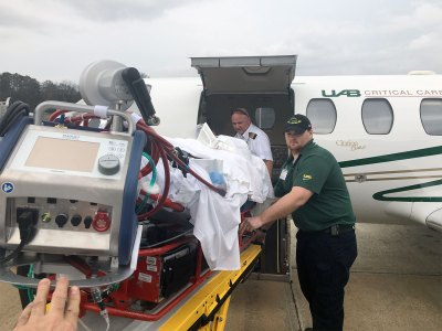 UAB's Critical Care Transport team puts Michelle into the jet to bring her to Birmingham on Christmas Eve. Michelle will board the plane again Thursday, March 31, to head back home to Chicago. (UAB Media)