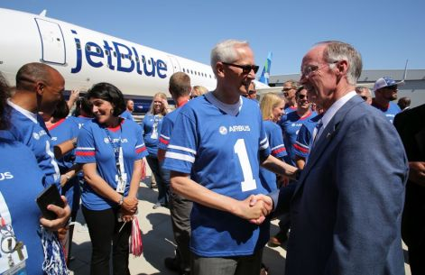 Alabama Gov. Robert Bentley, right, greets Final Assembly Line USA Vice President Ulrich Weber as a delivery ceremony is held Monday, April 25 for JetBlue A321 Ð - the first Airbus aircraft produced at Airbus U.S. Manufacturing Facility in Mobile, Ala. (Mike Kittrell/Alabama NewsCenter)