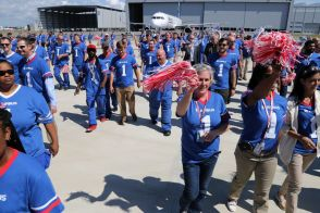 Employees celebrate during the delivery ceremony Monday, April 25, for JetBlue A321 Ð the first Airbus aircraft produced at Airbus U.S. Manufacturing Facility in Mobile, Ala. (Mike Kittrell/Alabama NewsCenter)