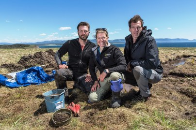 From left, Dr. Doug Bolender, Dr. Sarah Parcak and Historian Dan Snow on site in Point Rosee, Newfoundland. (Freddie Claire/BBC)