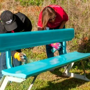 Volunteers added bright colors to childen's benches. (contributed)