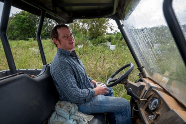 Justin Hill produces wildflower honey and beeswax products at his clover-rich farm and Eastaboga Bee Company near Lincoln. (Mark Sandlin/Alabama NewsCenter)