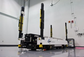 This automatic guided vehicle transports missiles throughout the Raytheon factory. (Simon Dawson/Bloomberg)