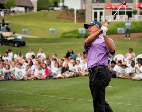 PGA Tour Champions professional Mike Goodes displays his skills to the students attending this week's Junior Clinic before the Regions Tradition tournament. (Christopher Jones/Alabama NewsCenter)