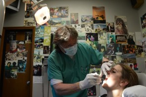 Vietnam veteran Barry Booth, DMD, at work in his dental office. (Karim Shamsi-Basha)