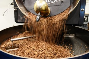 Coffee beans are loaded onto the roaster at Fairhope Roasting Co. (Karim Shamsi-Basha/Alabama NewsCenter)