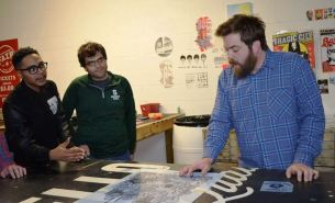 Brandon Watkins teaches screen printing at MAKEbhm. (Colin Nekritz/Alabama NewsCenter)