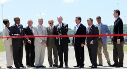 Gov. Robert Bentley is joined by elected officials and other leaders as he cuts the ribbon to officially open Interstate 22 at the Interstate 65 interchange. (Governor's Office/Jamie Martin)
