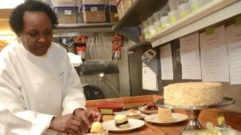 Dolester Miles, head pastry chef for three of Frank Stitt's Birmingham restaurants, with some of the creations that earned her a spot among the five James Beard Award finalists for the country's best pastry chef. (Karim Shamsi-Basha/Alabama NewsCenter)
