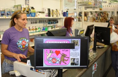 Sally Trufant works the front register at B&B Pet Stop in Mobile. (Robert DeWitt/Alabama NewsCenter)