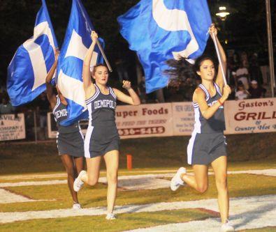 Demopolis High cheerleaders run onto field. (contributed)