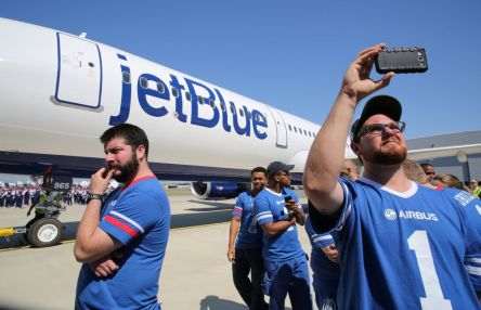 Employee Kevin Powell, right, records the delivery ceremony April 25 for JetBlue A321 Ð, the first Airbus aircraft produced at Airbus U.S. Manufacturing Facility in Mobile. (Mike Kittrell/Alabama NewsCenter)