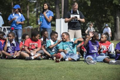 Students share a light moment between golf lessons. (Christopher Jones/Alabama NewsCenter)