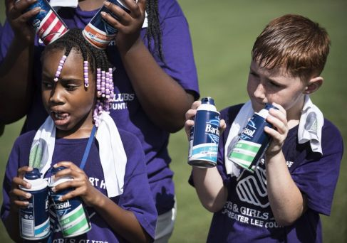 Students listen in and hold cans of Barbasol at the Junior Clinic. (Christopher Jones/Alabama NewsCenter)