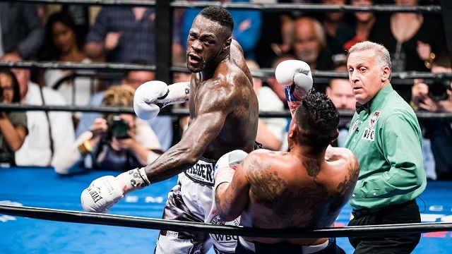 Deontay Wilder, left, uses his left hand to defeat Chris Arreola in Birmingham last year. (Nik Layman/Alabama NewsCenter)