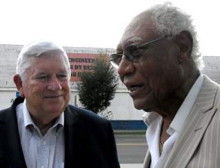 Birmingham Barons owner Don Logan talks with The Birmingham Times' Jesse Lewis at a ceremony unveiling a statue of baseball legend Willie Mays at Regions Field last year. (Solomon Crenshaw Jr./Alabama NewsCenter)
