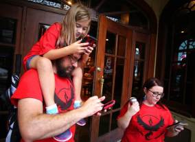Aria, 7, William and Christine Frye play Pokémon Go in Mobile. (Mike Kittrell/Alabama NewsCenter)