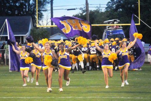 Jackson High cheerleaders run onto field. (contributed)