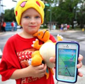 Justin Wainwright, 8, of Theodore plays Pokémon Go in Mobile. (Mike Kittrell/Alabama NewsCenter)