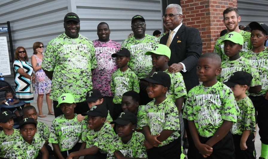 Birmingham Mayor William Bell stands with Titusville youth baseball and softball players. Baseball great Willie Mays has donated equipment to the Titusville sports program to coincide with a statue of Mays being unveiled at Regions Field. (Solomon Crenshaw Jr./Alabama NewsCenter)