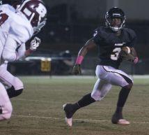 McAdory High player protects the ball. (Bernard Troncale/Alabama NewsCenter)