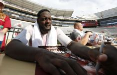 8-07-2016 MFB Fan Day Alabama offensive lineman Cam Robinson signs autographs at Fan Day. (Robert Sutton / UA Athletics)
