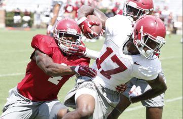 Alabama defensive back Eddie Jackson practices against wide receiver Cam Sims. (Robert Sutton / UA Athletics)