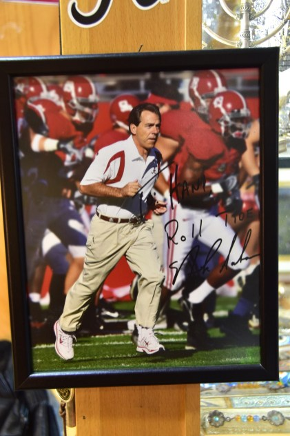 An autographed photo of Nick Saban holds an honored spot in Hani Imam's store in Jerusalem. (Karim Shamsi-Basha/Alabama NewsCenter)