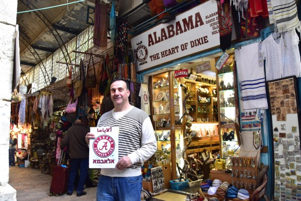 "University of Alabama alumnus Hani Imam outside his Jerusalem shop, ""Alabama -- The Heart of Dixie."" (Karim Shamsi-Basha/Alabama NewsCenter)"