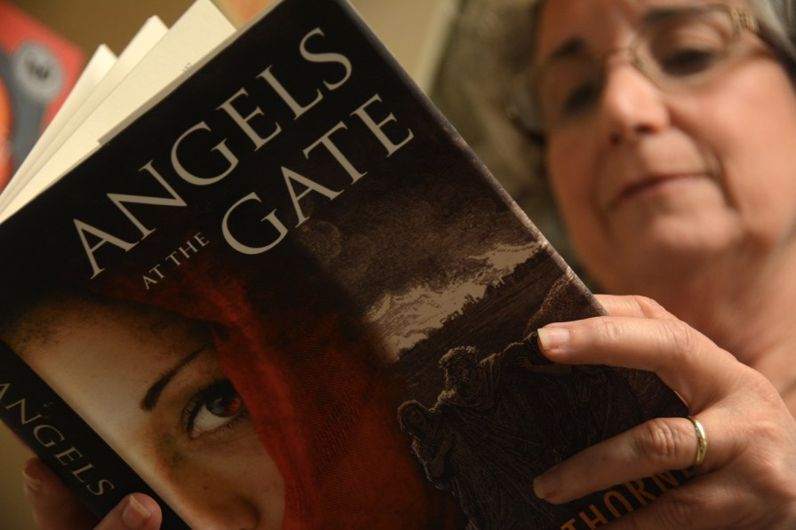 "Alabama author T.K. Thorne reads from her latest novel, ""Angels at the Gate."" (Karim Shamsi-Basha/Alabama NewsCenter)"