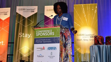 """Salaam Green reads her poem, """"Where the World Comes to Create,"""" at the Alabama Innovation Awards. Green's poem won a competition held by Create Birmingham to find the best poem that speaks to innovation in Alabama. (Michael Tomberlin / Alabama NewsCenter)"""