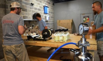 Vodka is filtered while the partners of Redmont Distilling bottle its Alabama Cotton Gin. (Michael Tomberlin / Alabama NewsCenter)