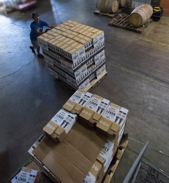 Efe Orgen moves freshly bottled beer at the Back Forty Beer Co. in Gadsden. (Bernard Troncale / Alabama NewsCenter)