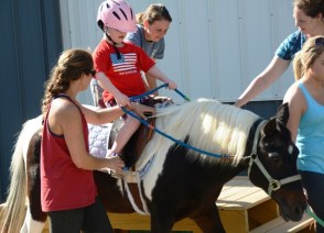 The gentle, friendly horses at the Red Barn have a therapeutic effect on the children who visit. (Karim Shamsi-Basha/Alabama NewsCenter)