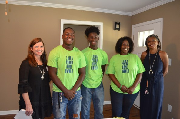 Charline Hall and her sons were among nearly a dozen families who received homes as part of the Habitat for Humanity Greater Birmingham Builders Blitz. Lovette Construction built Hall's home. (Michael Tomberlin / Alabama NewsCenter)