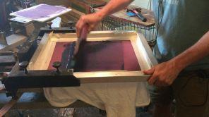 Scott Peek printing in his shop.