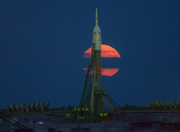 The moon, or supermoon, is seen rising behind the Soyuz rocket at the Baikonur Cosmodrome launch pad in Kazakhstan. NASA astronaut Peggy Whitson, Russian cosmonaut Oleg Novitskiy of Roscosmos, and ESA astronaut Thomas Pesquet will launch from the Baikonur Cosmodrome in Kazakhstan Nov. 18. (Bill Ingalls/NASA)