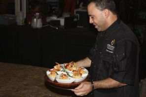 Chef John Scinco turns in dish in seafood competition. (Robert DeWitt/Alabama NewsCenter)