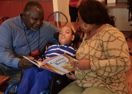 Nathaniel Fair and Christina Parkman love on their grandson, Curtis McDonald, at Ronald McDonald House. (Karim Shamsi-Basha/Alabama NewsCenter)