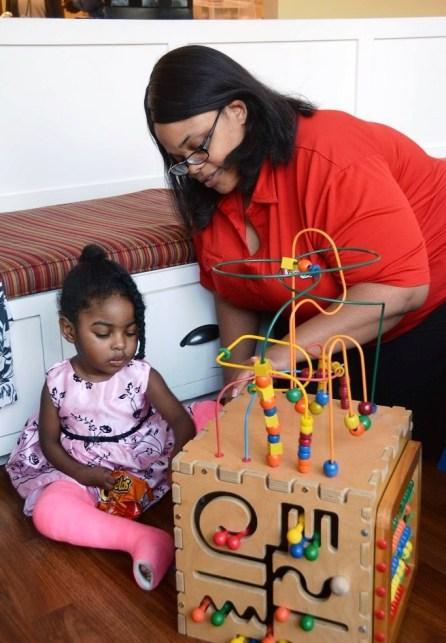 Victoria Johnson plays with her daughter Farriah at Ronald McDonald House in Birmingham. (Karim Shamsi-Basha/Alabama NewsCenter)