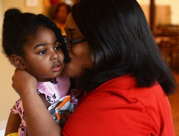 Victoria Johnson plays with her daughter Farriah at Ronald McDonald House in Birmingham. (Karim Shamsi-Basha/Alabama NewsCenter)
