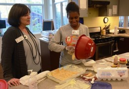 Katherine Estes Billmeier with volunteer Athena Jackson, who is making cookies for Thanksgiving at Birmingham's Ronald McDonald House. (Karim Shamsi-Basha/Alabama NewsCenter)
