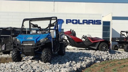 Polaris vehicles stand outside the company's factory in Huntsville. (Made in Alabama)