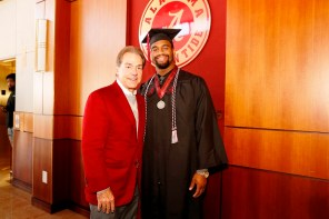 Nick Saban poses with Jonathan Allen, one of more than 30 Crimson Tide student-athletes graduation from the University of Alabama Saturday. (Robert Sutton/UA Athletics)