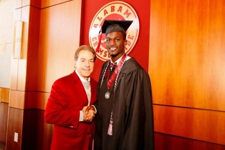 Nick Saban poses with Raheem Falkins, one of more than 30 Crimson Tide student-athletes graduation from the University of Alabama Saturday. (Robert Sutton/UA Athletics)