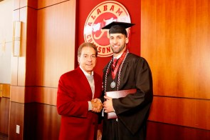 Nick Saban poses with Joshua Palet, one of more than 30 Crimson Tide student-athletes graduation from the University of Alabama Saturday. (Robert Sutton/UA Athletics)