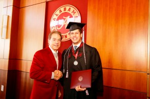 Nick Saban poses with Cole Mazza, one of more than 30 Crimson Tide student-athletes graduation from the University of Alabama Saturday. (Robert Sutton/UA Athletics)