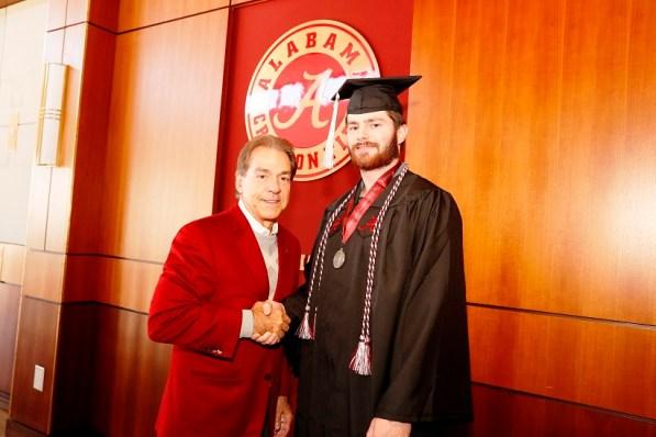 Nick Saban poses with Truett Harris, one of more than 30 Crimson Tide student-athletes graduation from the University of Alabama Saturday. (Robert Sutton/UA Athletics)