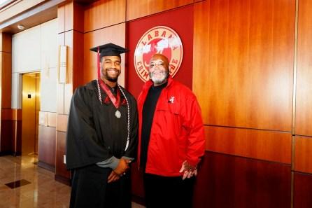 New Crimson Tide graduate Jonathan Allen poses with his position coach Karl Dunbar, defensive line coach for the University of Alabama football team. (Robert Sutton/UA Athletics)